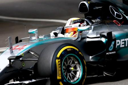 Hamilton takes pole from stumbling Rosberg
