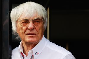 Bernie Ecclestone in front of a black motorhome