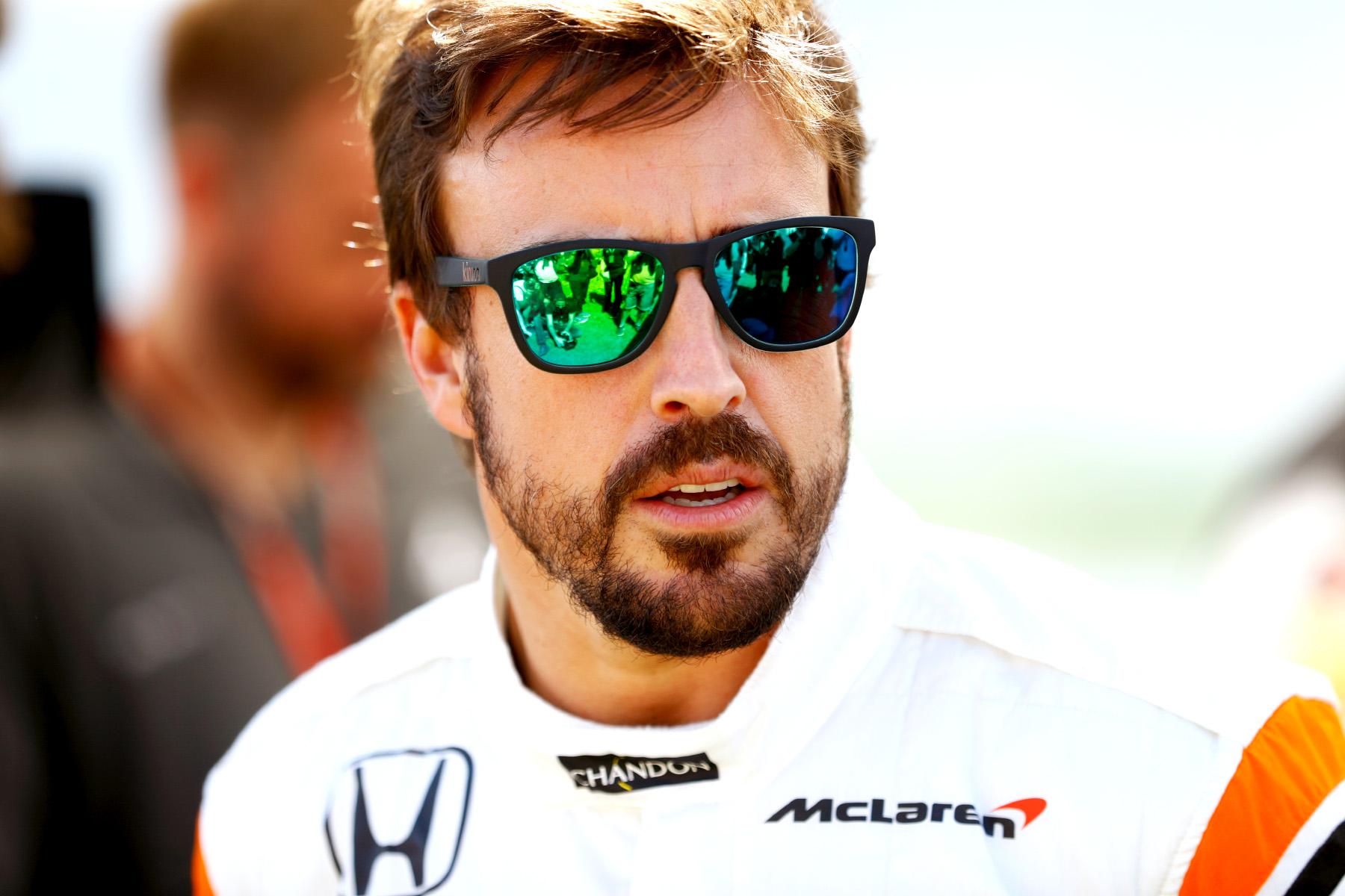 Alonso denies Webber's quit rumour