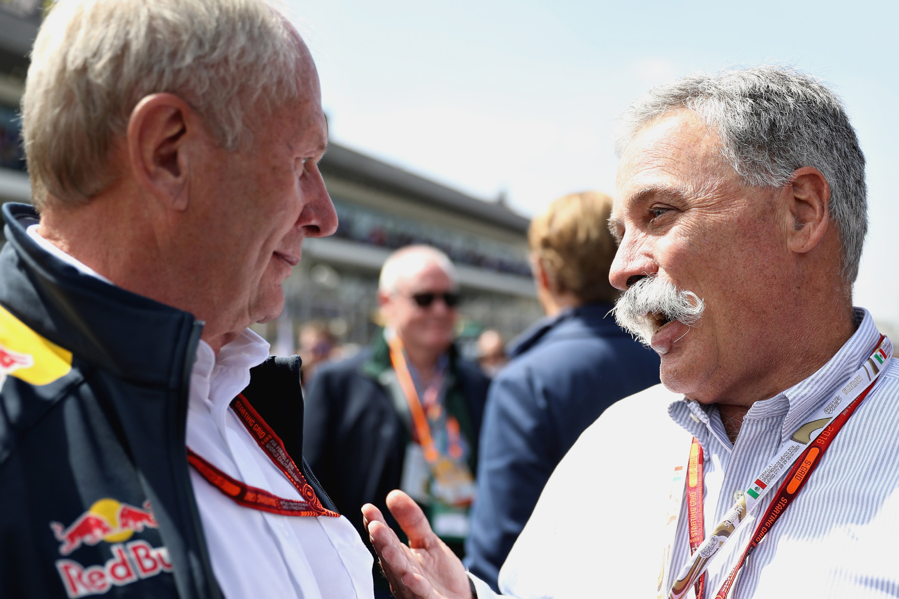 Helmut Marko talks to Formula One Group chairman Chase Carey