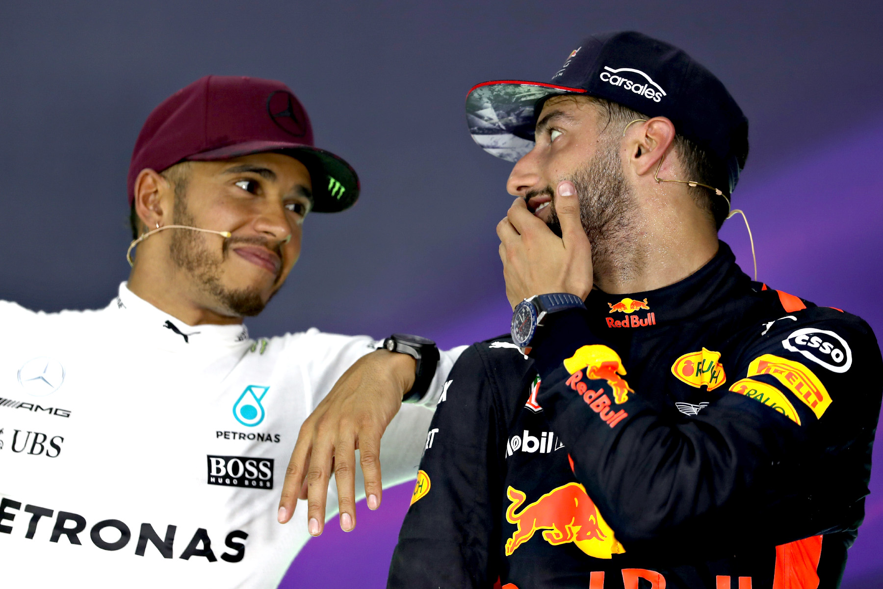 Lewis Hamilton and Daniel Ricciardo talk in an FIA press conference.