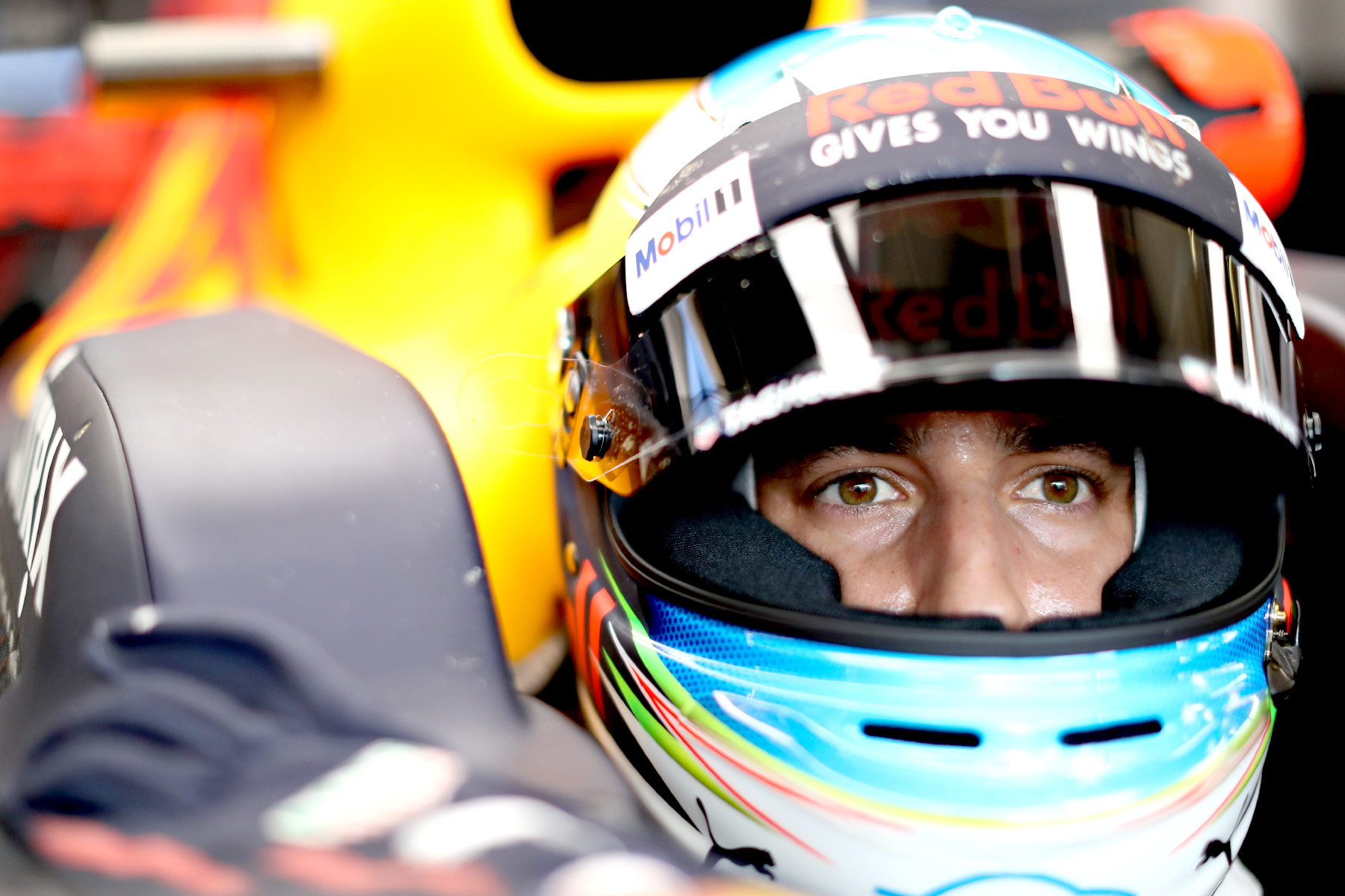Daniel Ricciardo sits in his Red Bull Racing car at the 2017 Austrian Grand Prix