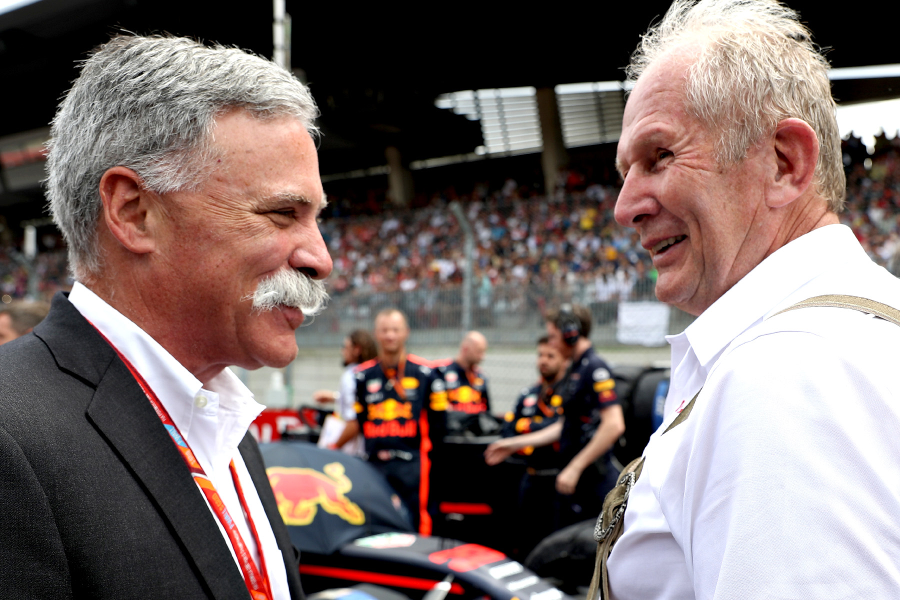Chase Carey and Helmut Marko on the grid of the 2017 Austrian Grand Prix.