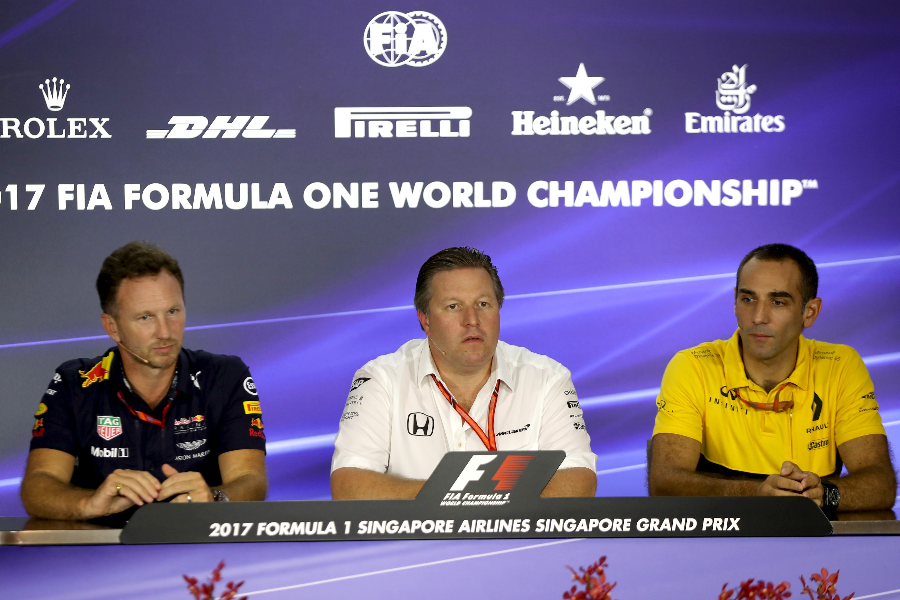 Red Bull Racing principal Christian Horner, McLaren executive director Zak Brown, and Renault Sport managing director Cyril Abiteboul at the 2017 Singapore Grand Prix.