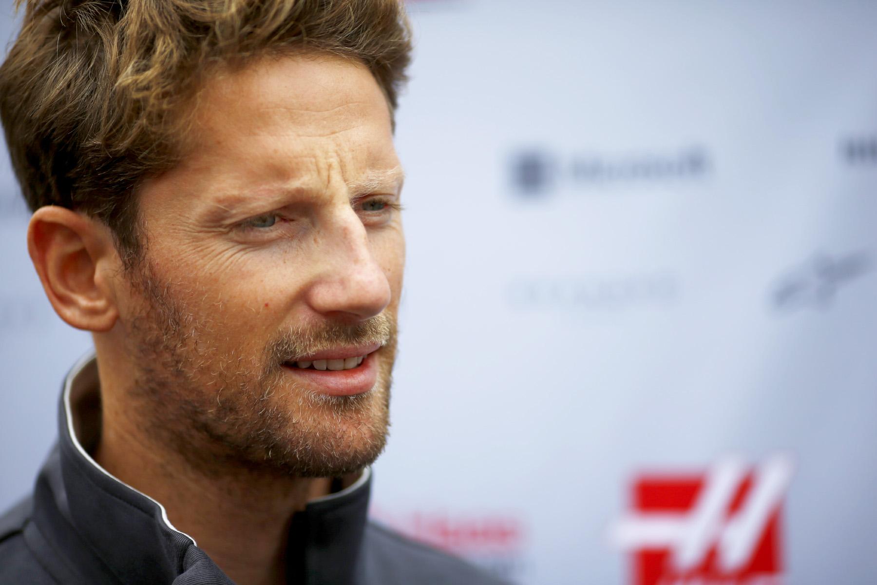Romain Grosjean speaks to reporters at the 2017 Japanese Grand Prix.