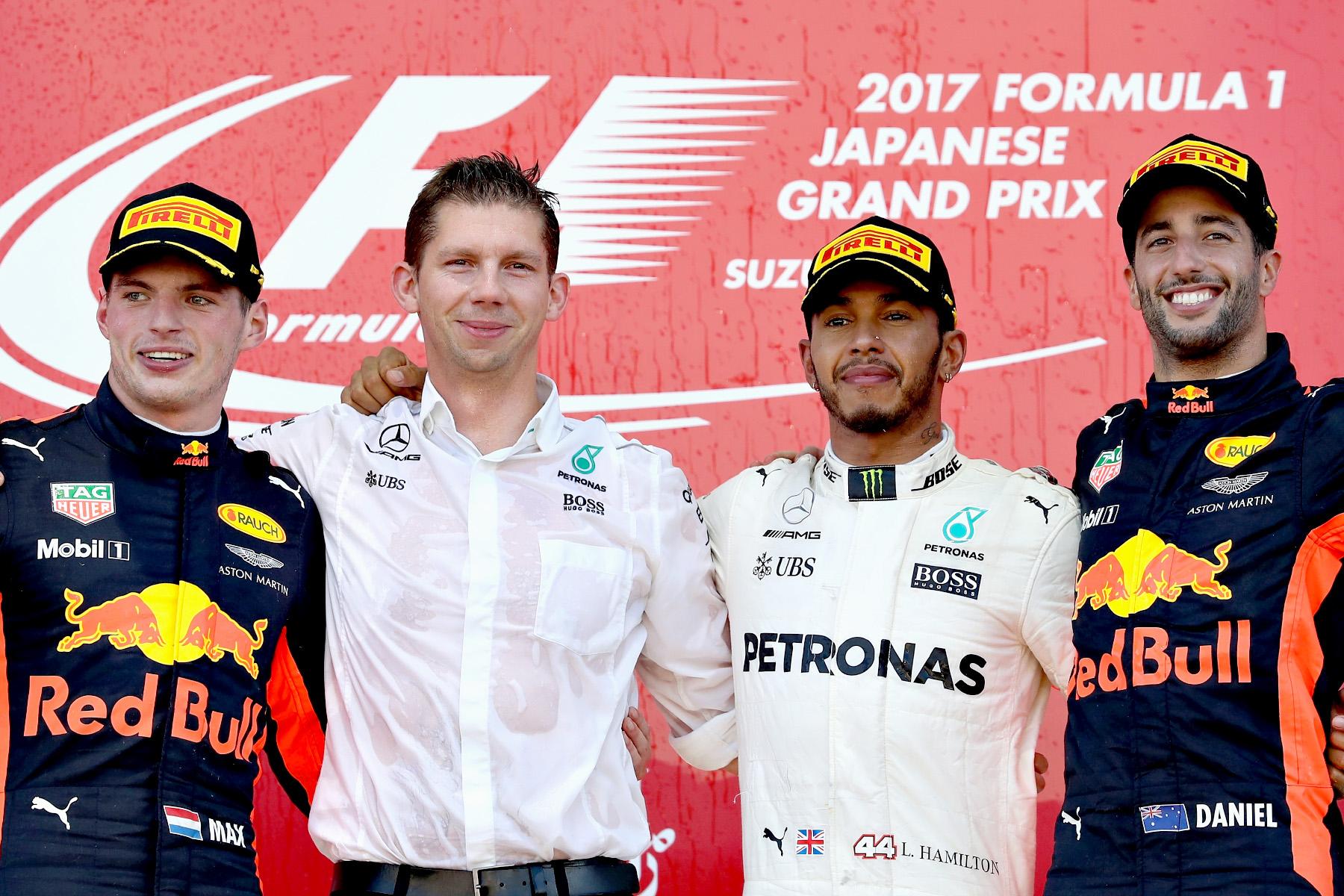 Max Verstappen, Lewis Hamilton and Daniel Ricciardo celebrate on the podium with Mercedes strategist James Vowels on the podium of the 2017 Japanese Grand Prix.