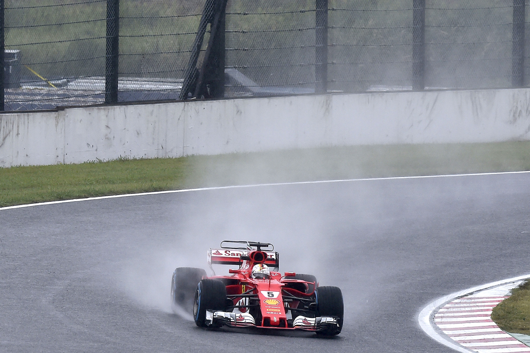 Sebastian Vettel takes to the wet track during FP2 at the 2017 Japanese Grand Prix.