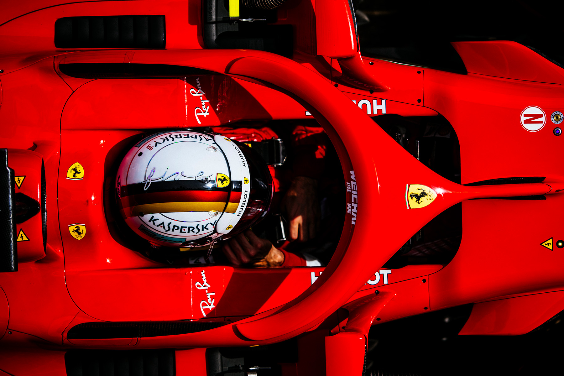 Sebastian Vettel sits in his Ferrari during preseason testing.