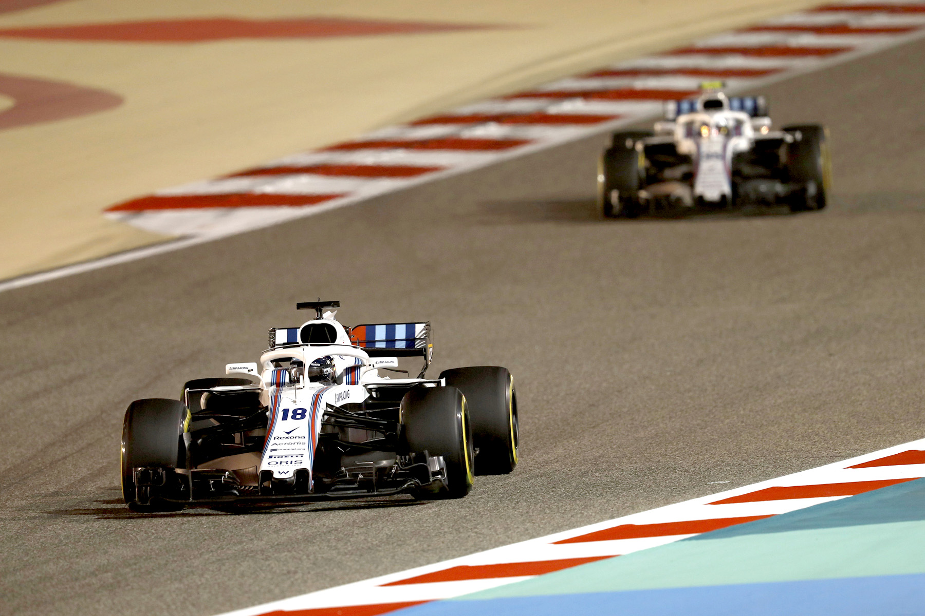 Lance Stroll and Sergey Sirotkin on track at the 2018 Bahrain Grand Prix.