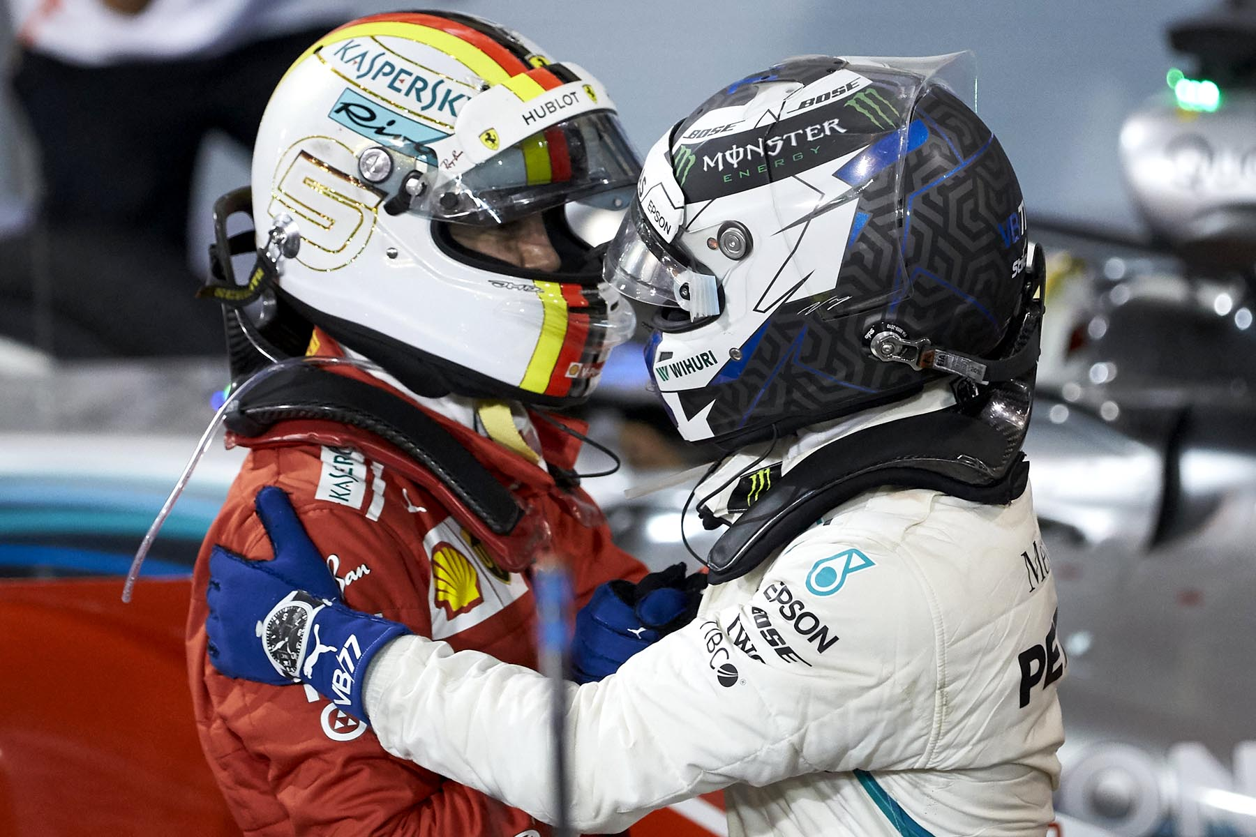 Vlatteri Bottas congratulates Sebastian Vettel on winning the 2018 Bahrain Grand Prix.