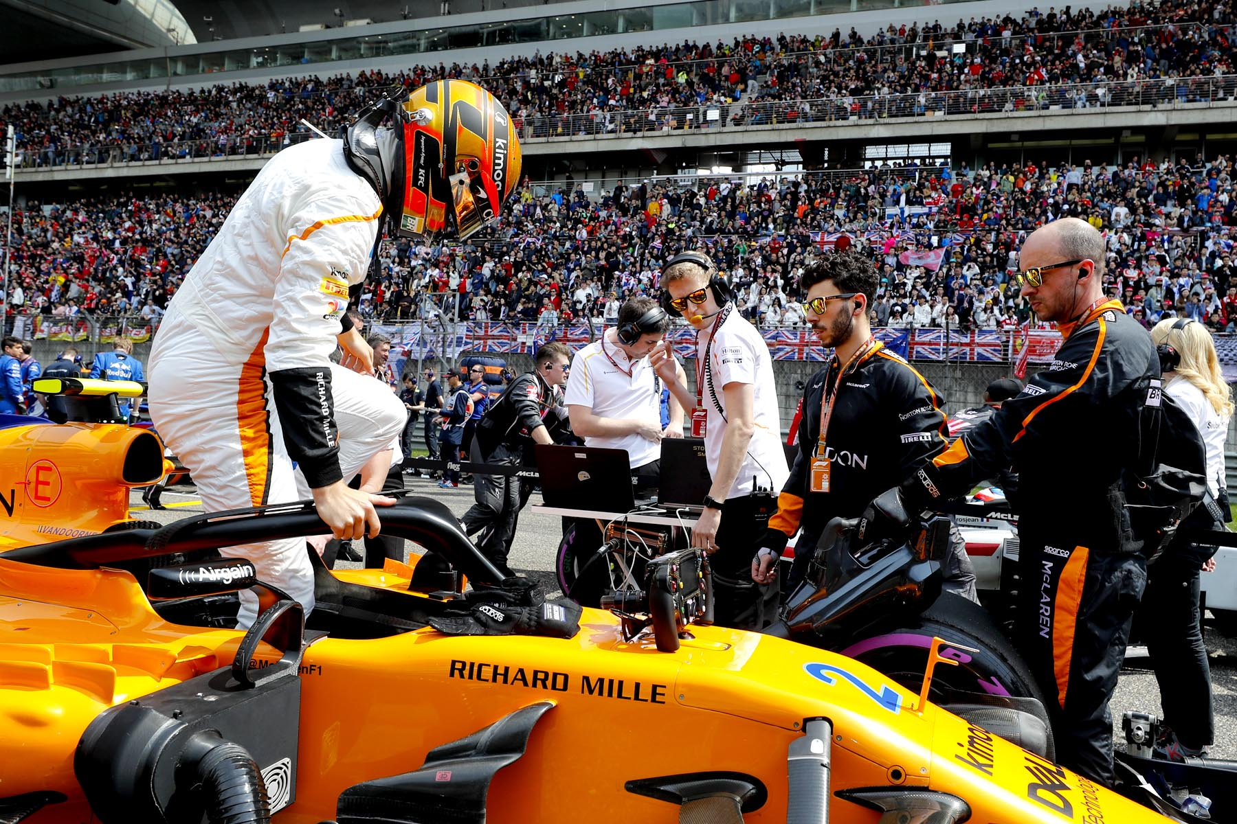 Stoffel Vandoorne gets out of his car on the grid at the 2018 Chinese Grand Prix.