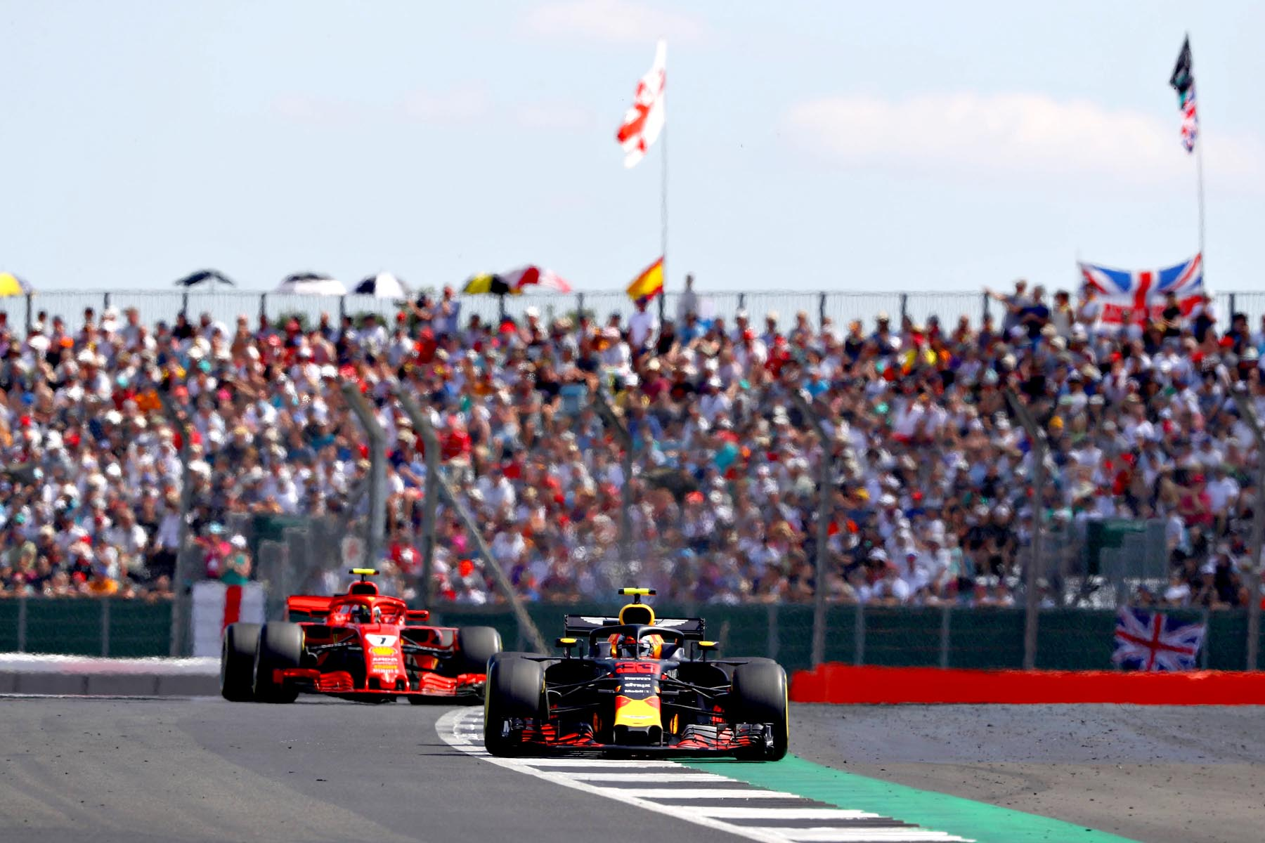 Max Verstappen and Kimi Raikkonen on track at the 2018 British Grand Prix.