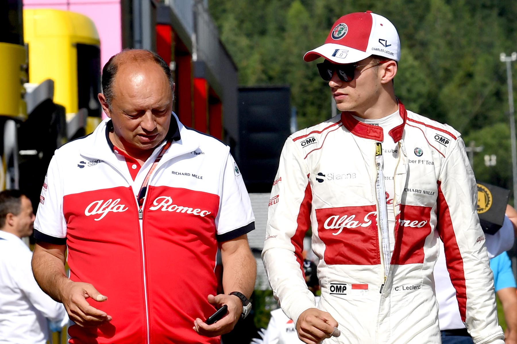Charles Leclerc (right) talks with Sauber team principal Frederic Vasseur (left).