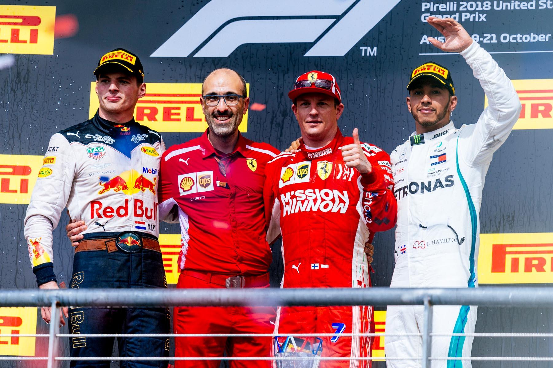 Kimi Raikkonen celebrates on the podium at the 2018 United States Grand Prix.