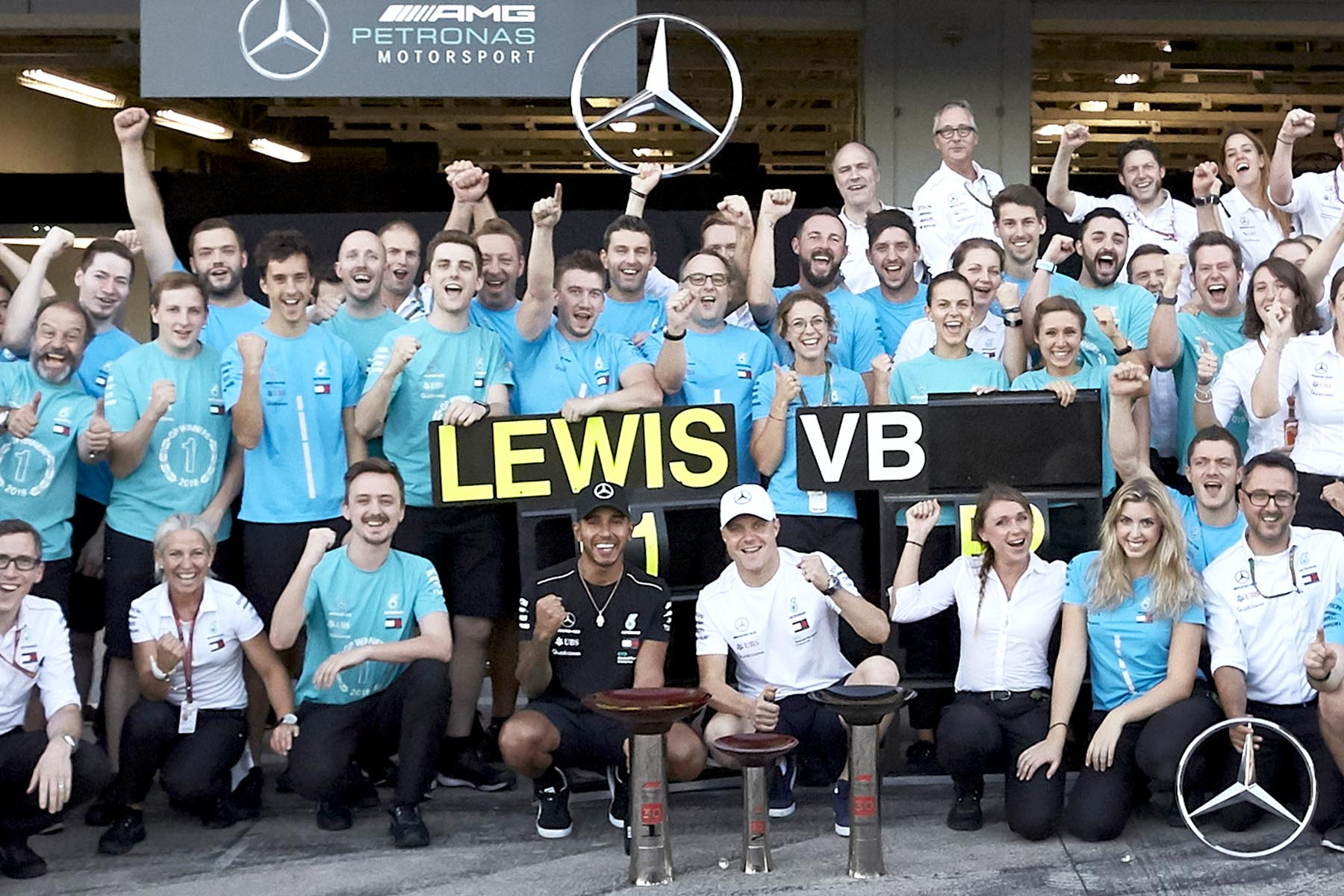 The Mercedes team celebrates victory at the 2018 Japanese Grand Prix.