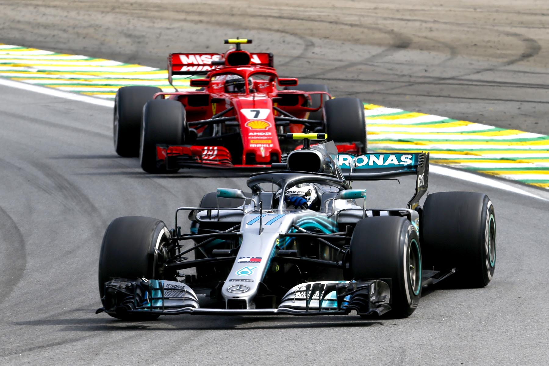 Mercedes's Valtteri Bottas leads Ferrari's Kimi Raikkonen at the 2018 Brazilian Grand Prix.