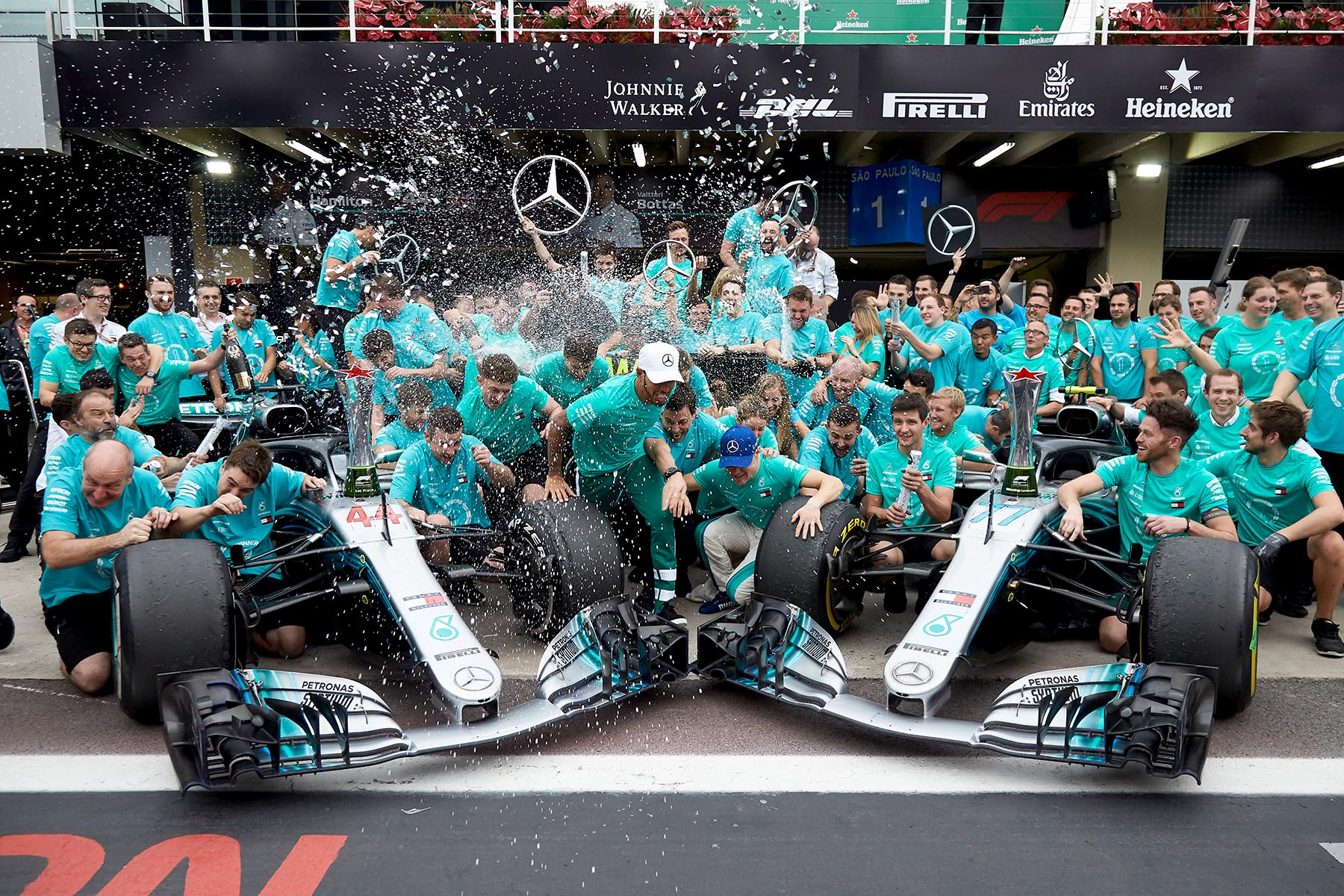 The Mercedes team celebrates the 2018 constructors world championship in Brazil.