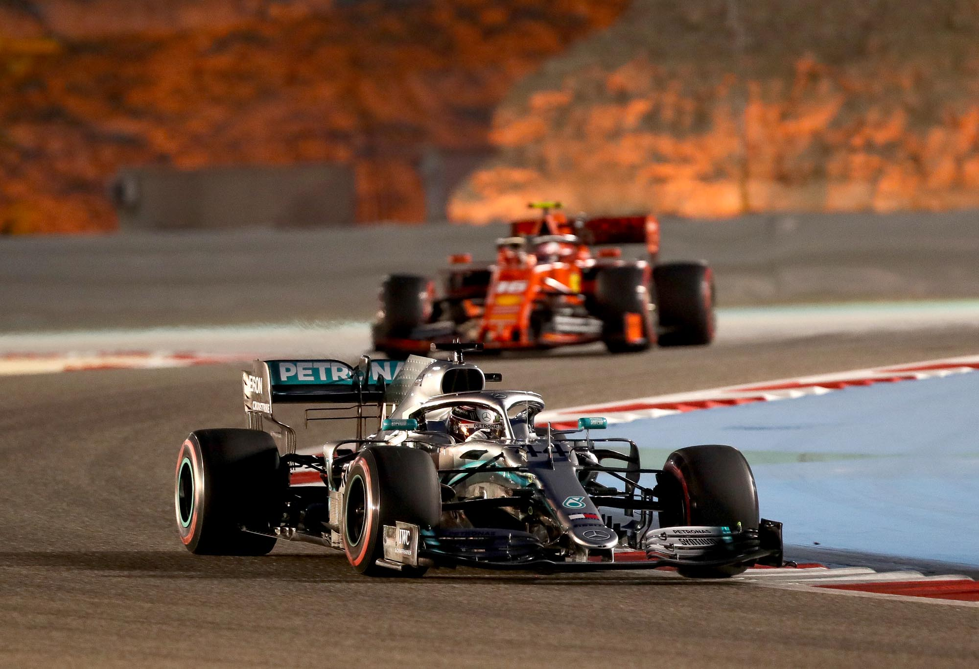 Lewis Hamilton leads Charles Leclerc on track at the 2019 Bahrain Grand Prix.